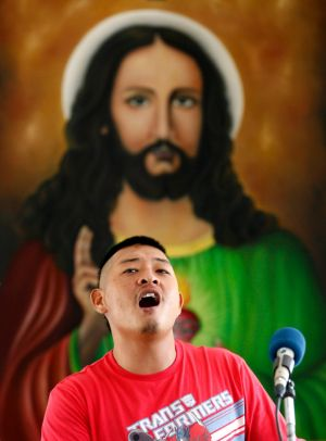 Andrew Chan singing praise during mass.