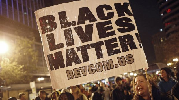 Protesters in Oakland, California, hold a sign during a march against the New York City grand jury's decision not to ...