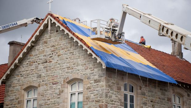 St Josephs College on Gregory Tce suffered heavy hail damage to its tiled roofs.