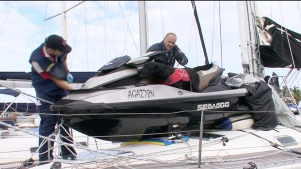 Police searching Simon Golding's yacht.