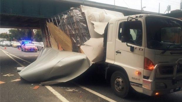 The truck under the rail bridge.