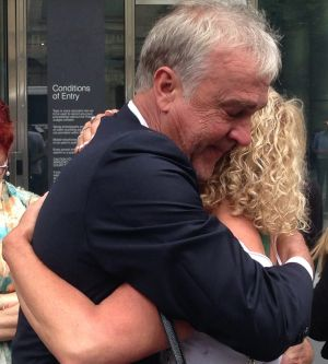 Katie Louise's parents Michael Broadbent and Teresa Doyle embrace outside the County Court on Friday.