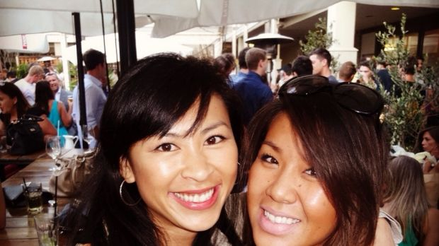 Tien Le, left, with her sister Diana.