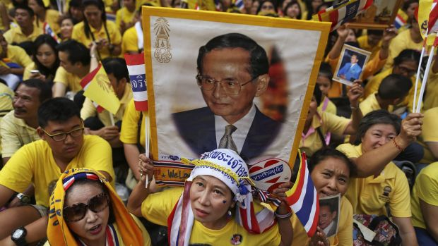 Well-wishers look towards the building where Thailand's King Bhumibol Adulyadej is residing.