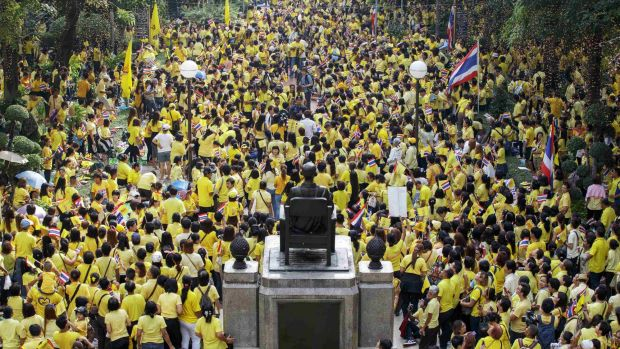 Well-wishers gather to pray for the health and celebrate the birthday of Thailand's King Bhumibol Adulyadej at Siriraj ...