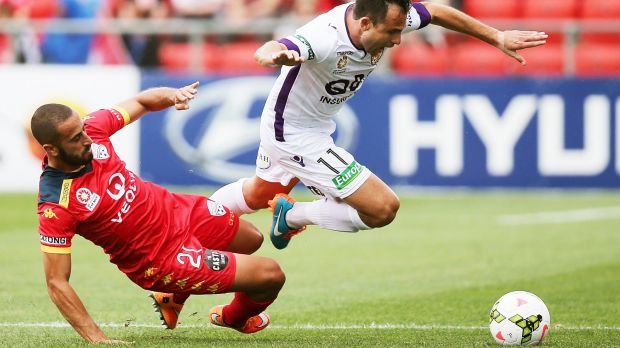 Back in the game: Tarek Elrich tackles Richard Garcia of Perth Glory.