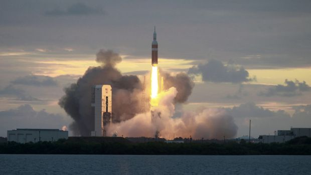 The Delta IV Heavy rocket with the Orion spacecraft lifts off from the Cape Canaveral Air Force Station.