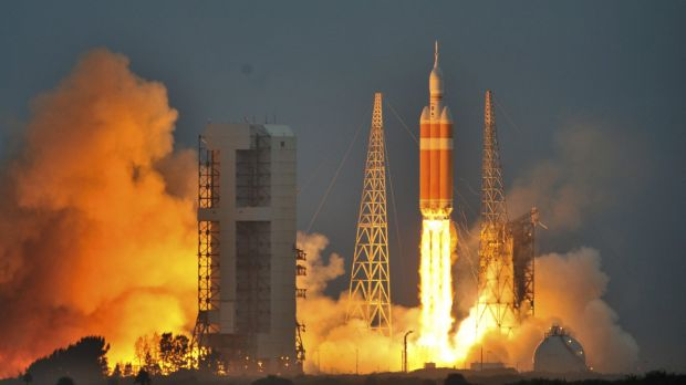 Blast off: The Delta IV Heavy rocket with the Orion spacecraft lifts off from the Cape Canaveral Air Force Station in ...