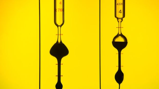 Oil wars: Oil samples at a refinery in Nizhny Novgorod, Russia. Moscow relies on an oil price of $US100 per barrel.