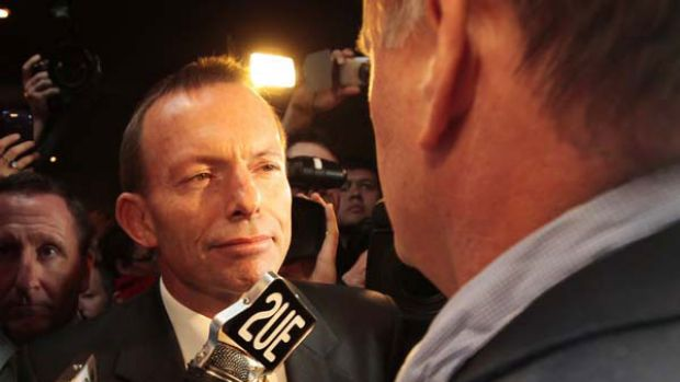 "Here's looking at you: Tony Abbott is confronted by ""journalist"" Mark Latham at the Penrith RSL Club yesterday. ..."