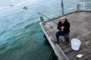 On the spot: Sam Psanis fishing on the Albert Park jetty.