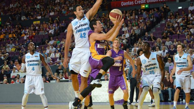 Power game: Sydney Kings guard Jason Cadee goes in for a lay-up against the NZ Breakers on Saturday night.