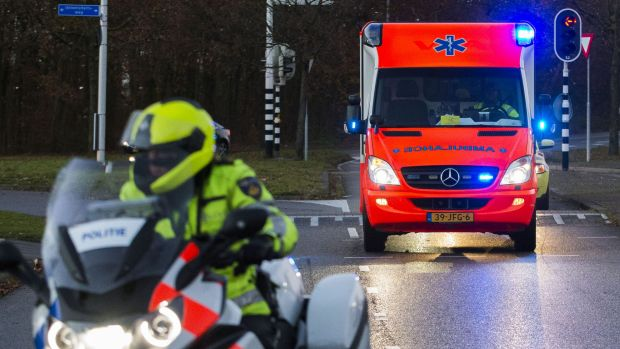 An ambulance carrying a UN peacekeeper with Ebola arrives at the University Medical Centre in Utrecht, the Netherlands.