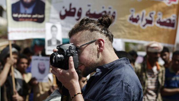 Luke Somers takes pictures of a demonstration against detention of Yemenis at Guantanamo Bay in the Yemeni capital Sanaa ...