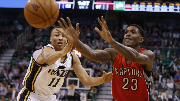 Battling for court time: Dante Exum, who was taken fifth in the draft by Utah, vies for possession with Toronto guard ...