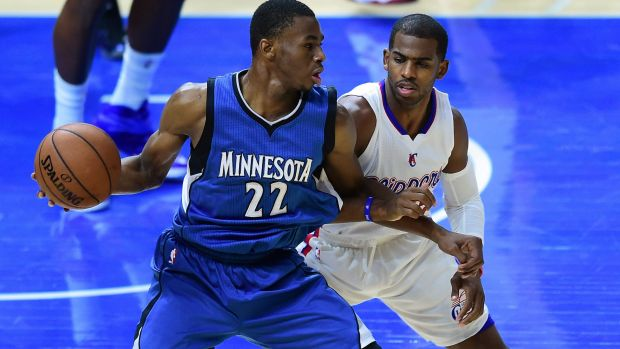 Future force: No.1 draft pick Andrew Wiggins posts up for Minnesota against Clippers veteran Chris Paul.