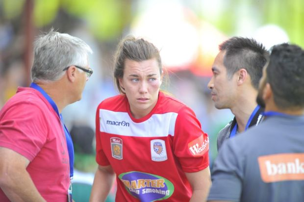 Perth Glory goal keeper Mackenzie Arnold after a clash with Canberra United player Michelle Heyman