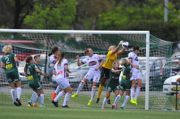Canberra united and Perth Glory teams in action.