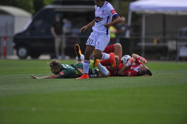 Canberra United player Michelle Heyman clashes with Perth Glory goal keeper Mackenzie Arnold.