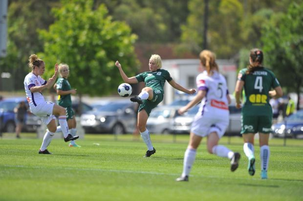 Canberra united player Catherine Brown in action .