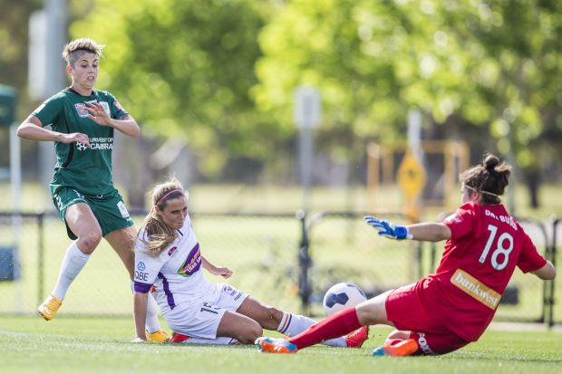 Michelle Heyman of Canberra United attacks the Perth goal with Shelina Zadorsky and Gabrielle Dal Busco defending.