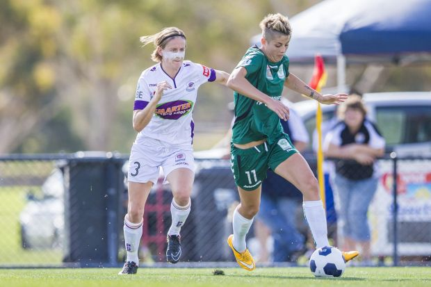 Michelle Heyman of Canberra United and Carys Hawkins of Perth Glory challenge for the ball.