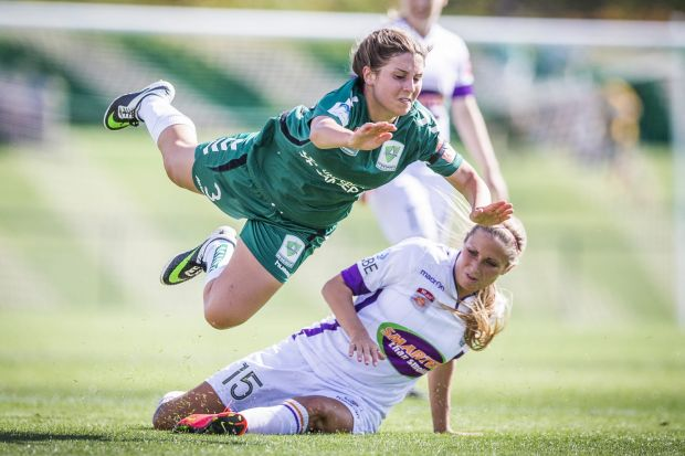 Canberra United's Julia De Angelis falls over Perth Glory's Shelina Zadorsky.