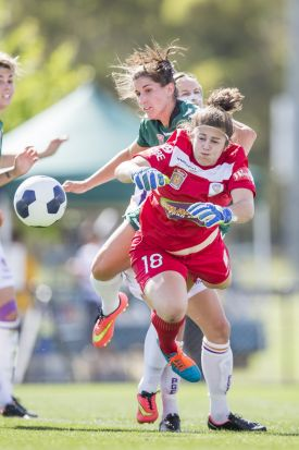 Gabrielle Dal Busco of Perth Glory and Caitlin Munoz of Canberra United attack the ball.