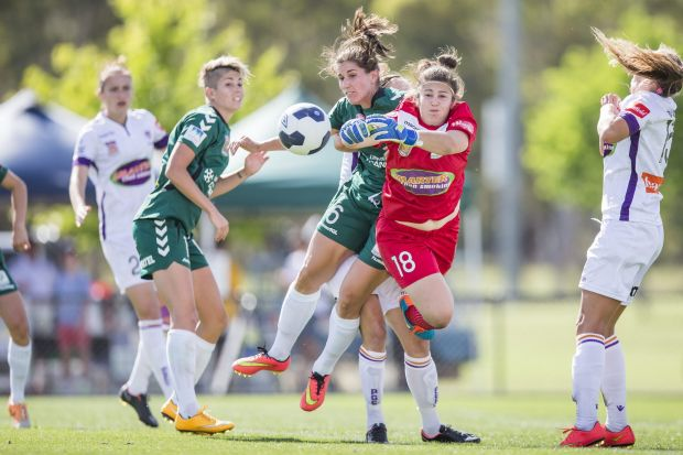 Gabrielle Dal Busco of Perth Glory and Caitlin Munoz of Canberra United attack the ball in front of the Perth goal.