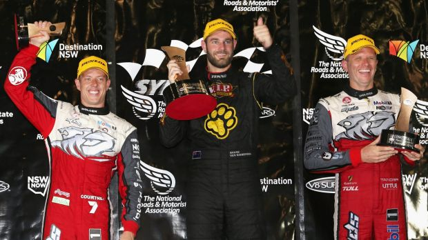 Shane van Gisbergen celebrates his race win ahead of James Courtney (left) and Garth Tander (right).