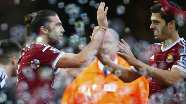 West Ham's Andy Carroll celebrates his second goal at home against Swansea on Sunday.