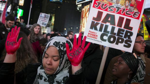 Don't shoot: Demonstrator Maryam Said raises her painted hands during a protest against a grand jury's decision not to ...