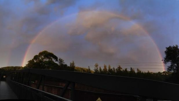 Leftover from storms in Sydney's north-west brought more rain and thunder, and a dawn rainbow.