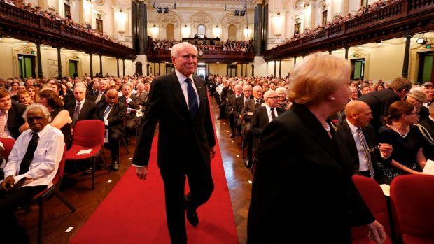 Former prime minister John Howard takes his seat at Gough Whitlam's state memorial service.