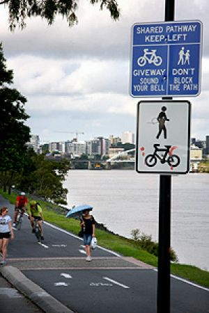 Pedestrians and cyclists share the Bicentennial Bikeway, alongside Coronation Drive in Toowong.