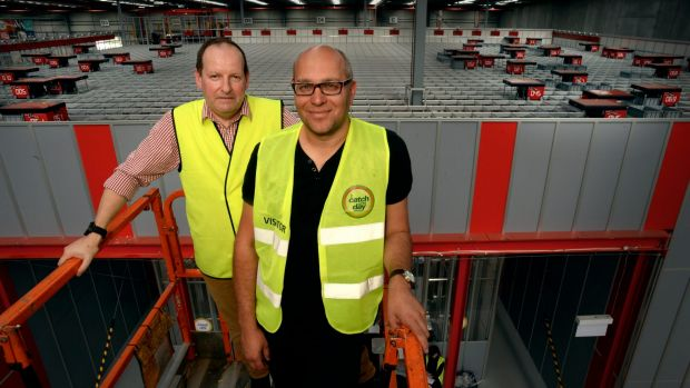 Catch Group head of logistics Jon Northorpe (left) and founder Gabby Leibovich on a cherry picker overseeing the ...