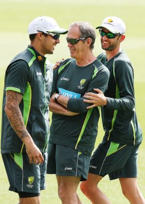 Light-hearted moment: Australian spinner Nathan Lyon hides behind team doctor Peter Brukner after getting paceman ...