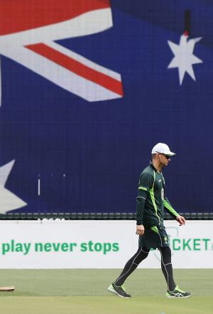 Taking it slowly: Michael Clarke on one of his laps of Adelaide Oval.