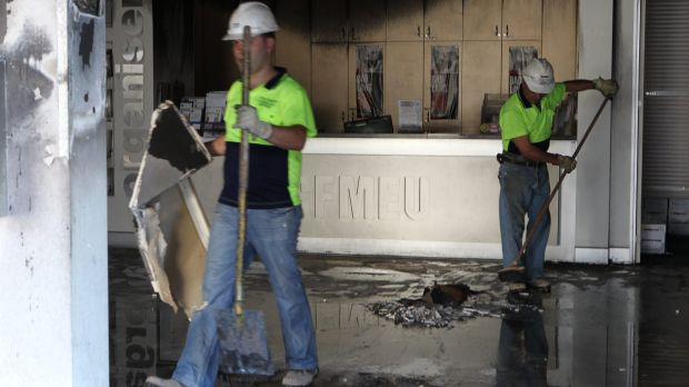 Arson attack: The clean-up at the CMFEU site at Lidcombe after the ram raid and fire in 2010.
