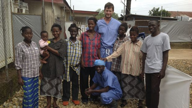 Ian Crozier and a nurse with Ebola survivors at Kenema Government Hospital.