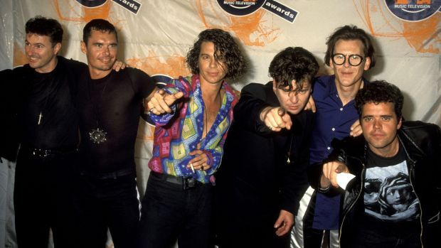Superstars: Garry Beers and INXS during their heyday in the early 1990s.