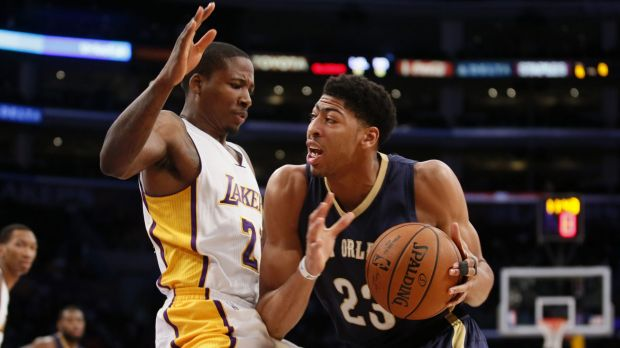 Force of nature: Anthony Davis takes it to the hoop for New Orleans against Lakers opponent Wayne Ellington.