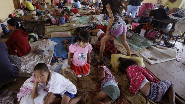 Residents living along coastal areas in Manila take shelter in an evacuation centre.