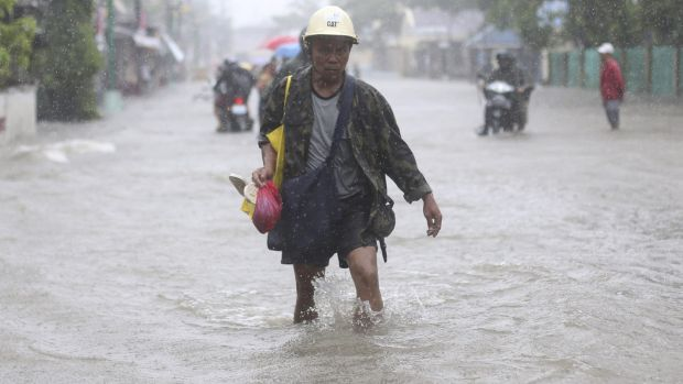 A resident wades in floodwaters bought by Typhoon Hagupit in Camarines Sur province, eastern Philippines, on Monday.
