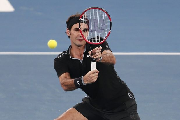 Roger Federer of the Micromax Indian Aces hits a return to Tomas Berdych of the Singapore Slammers during their men's ...