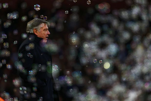 West Ham United manager Sam Allardyce is surrounded by bubbles as he watches his team play Swansea City during their ...