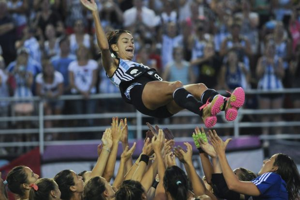 Argentina's female hockey players lift teammate Luciana Aymar as they celebrate after winning the Women's Champions ...