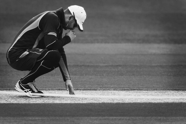 Michael Clarke inspects the pitch during an Australian nets session at Adelaide Oval.