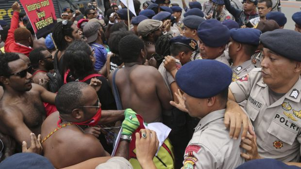 Unresolved conflict: Papuan activists scuffle with police during a rally marking the 53rd anniversary of the Free Papua ...