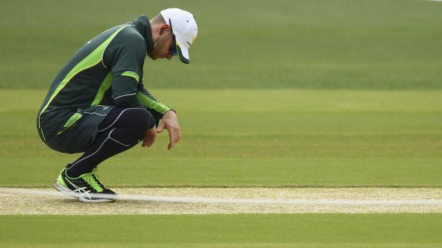 Michael Clarke inspects the Adelaide Oval pitch before the first Test against India.